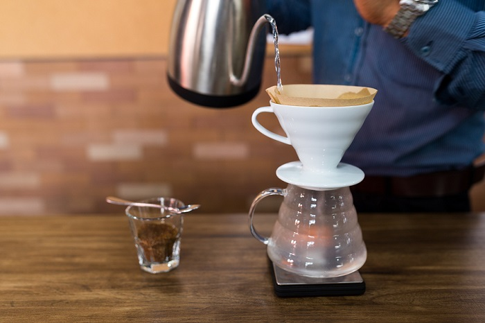 Barista-making-pour-over-coffee